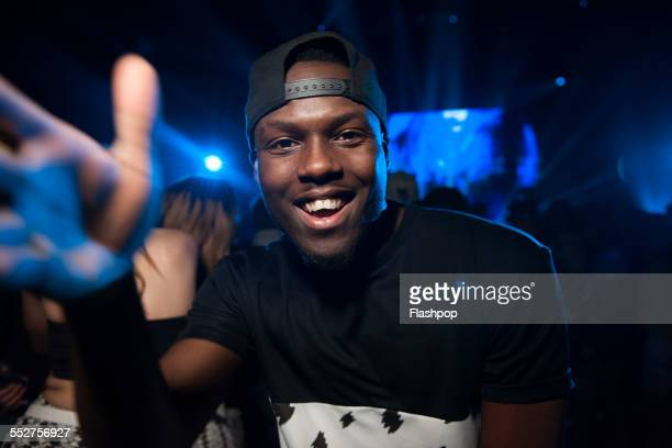 portrait of man having fun at a music event - concert stock pictures, royalty-free photos & images