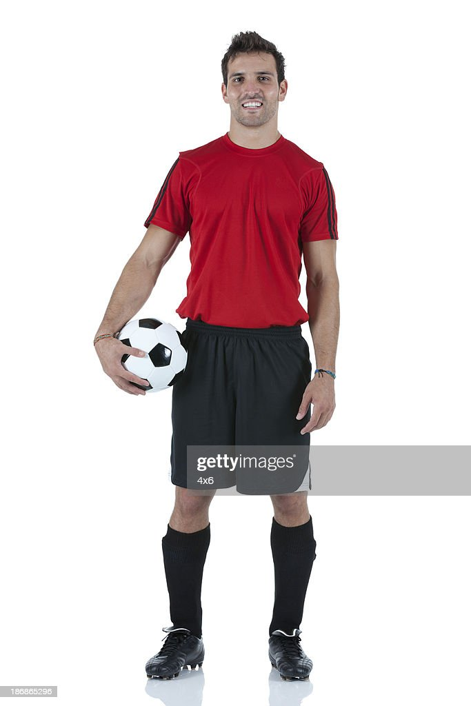 Portrait of man holding a football : Stock Photo