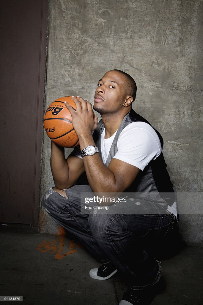 Portrait of man holding basketball : Stock Photo