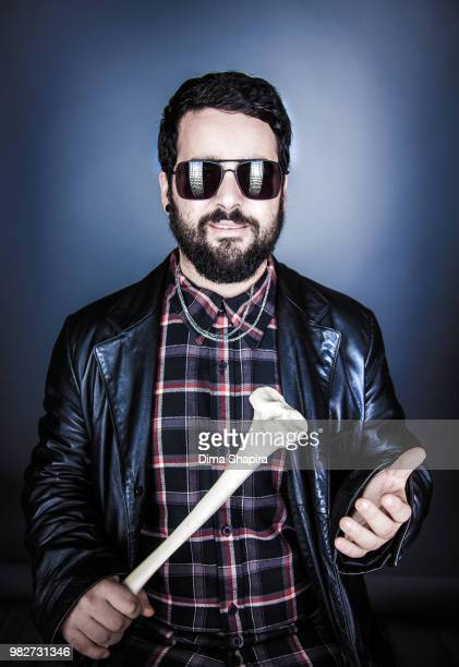 Portrait of man holding bone