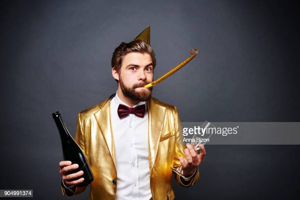 Portrait of man holding bottle of champagne and champagne glass. Debica, Poland
