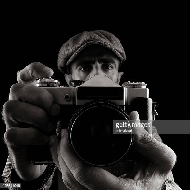 portrait of man holding camera and taking his self portrait - grip film crew stock photos and pictures