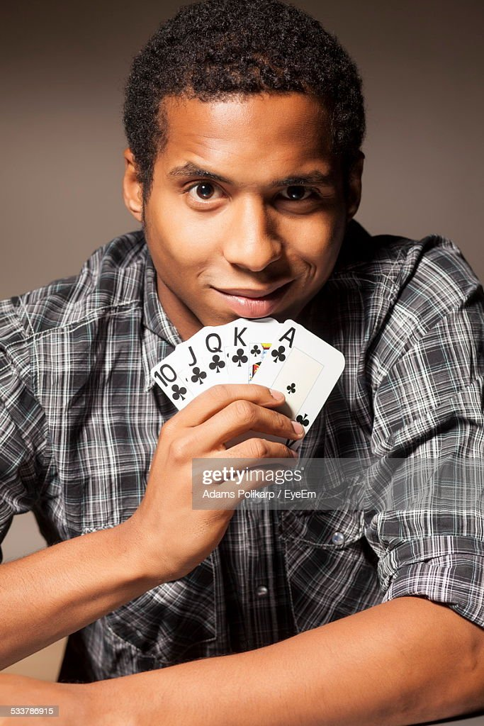 Portrait Of Man Holding Cards : Foto stock