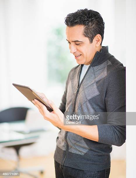 Portrait of man holding digital tablet