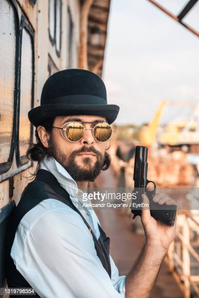 portrait of man holding hat - australian capital territory stock pictures, royalty-free photos & images