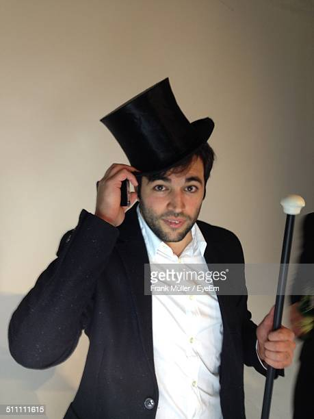 portrait of man holding stick - top hat stock pictures, royalty-free photos & images