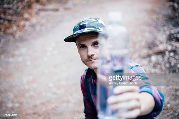 Portrait of man holding water bottle, Big Sur, California, USA