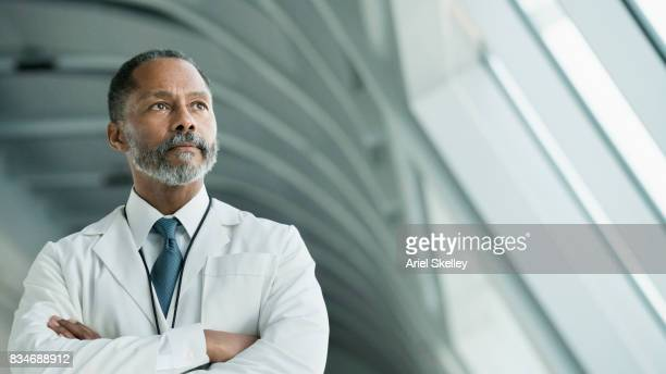 portrait of man in a lab coat in modern building - looking away stock pictures, royalty-free photos & images