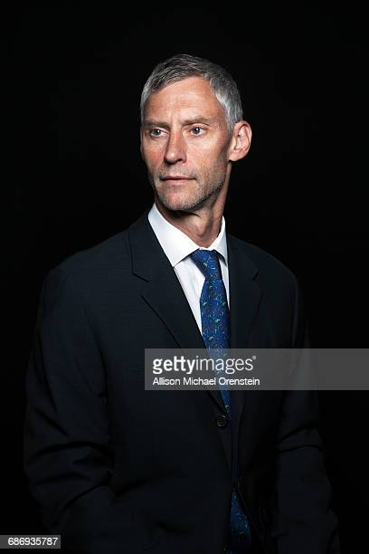 Portrait of man in a suit in his 50's