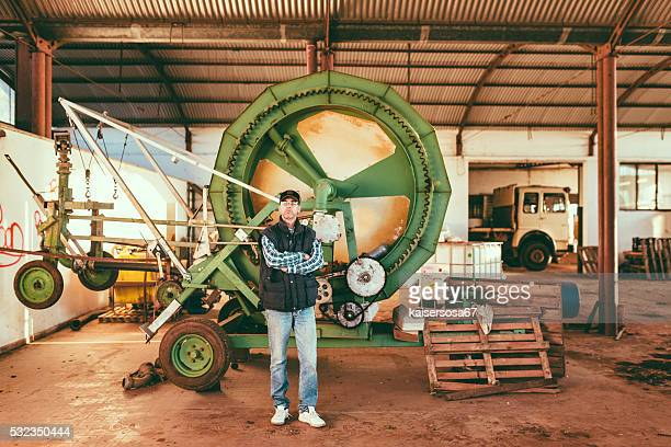 Portrait of man in agricultural shed