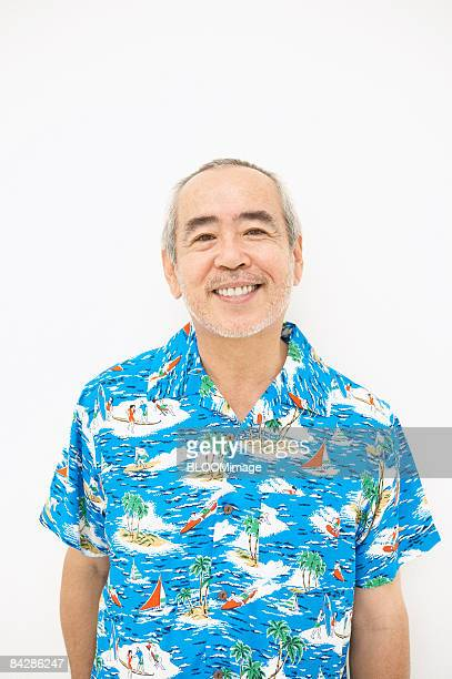 Portrait of Man in Aloha shirt, smiling, close-up
