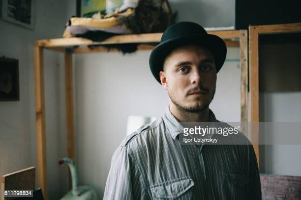 Portrait of man in art studio