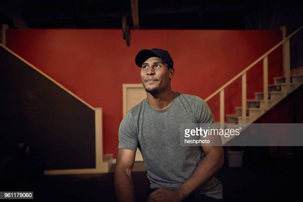 portrait of man in baseball cap looking away - heshphoto stock pictures, royalty-free photos & images