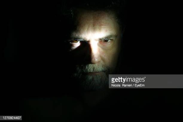 portrait of man in black background - one man only stock pictures, royalty-free photos & images