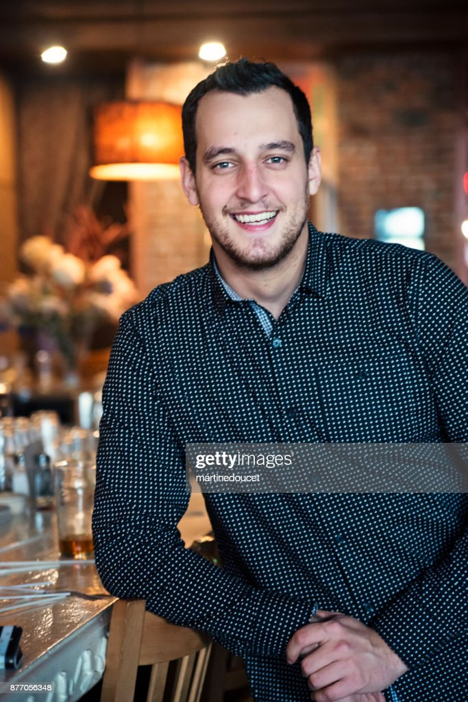 Portrait of man in black shirt in a bar. : Stock Photo