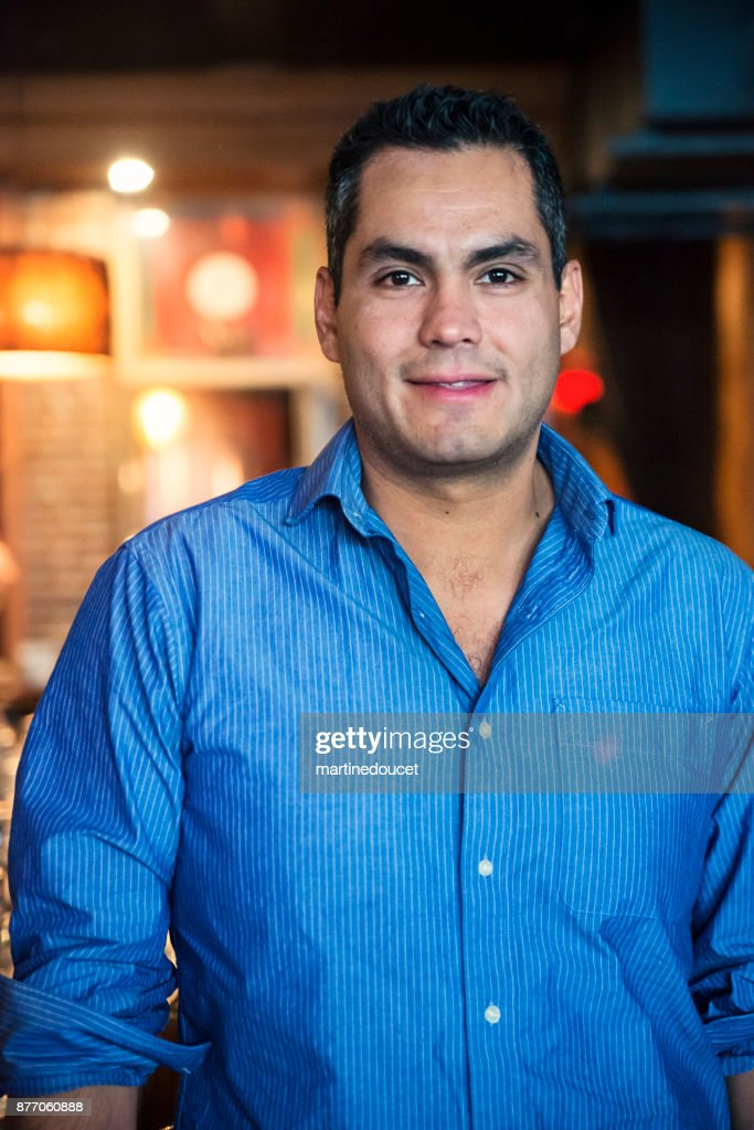Portrait of man in blue shirt in a bar. : Stock Photo