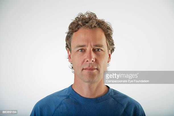 "portrait of man in blue sweatshirt - ""compassionate eye"" stock pictures, royalty-free photos & images"