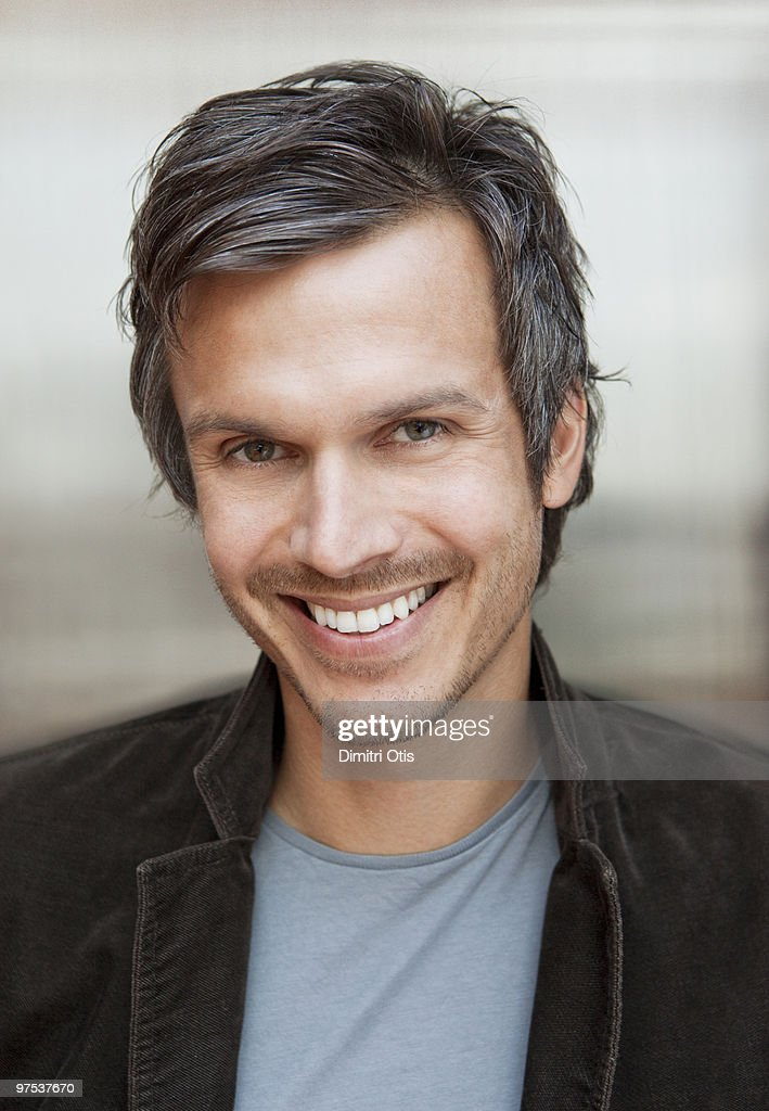 Portrait of man in casual clothes smiling : Stock Photo