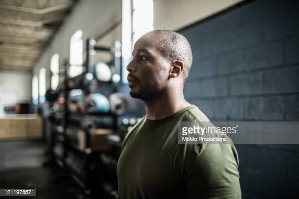 portrait of man in cross training gym - khaki stock pictures, royalty-free photos & images