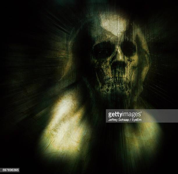 portrait of man in demon mask against black background - demons stock photos and pictures