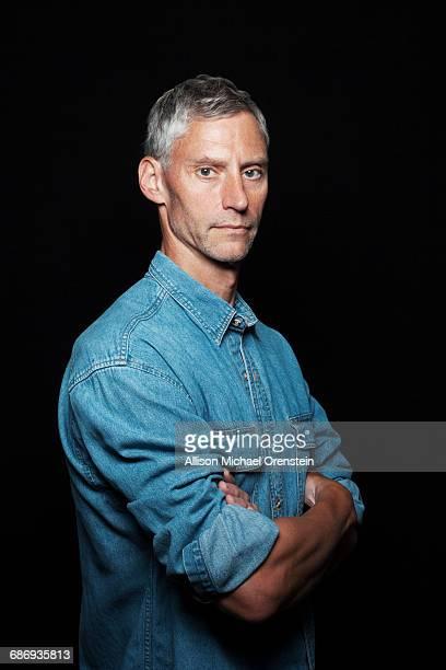 Portrait of man in denim shirt in his 50's