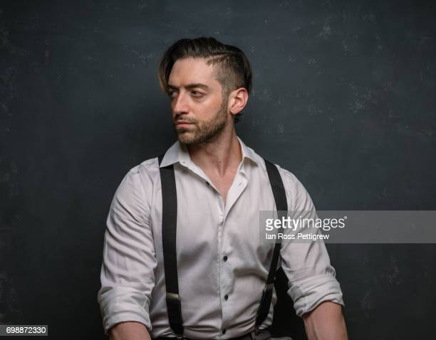 portrait of man in dress shirt - suspenders stock pictures, royalty-free photos & images