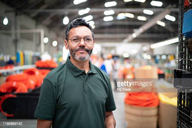 portrait of man in factory - brazilian ethnicity stock pictures, royalty-free photos & images