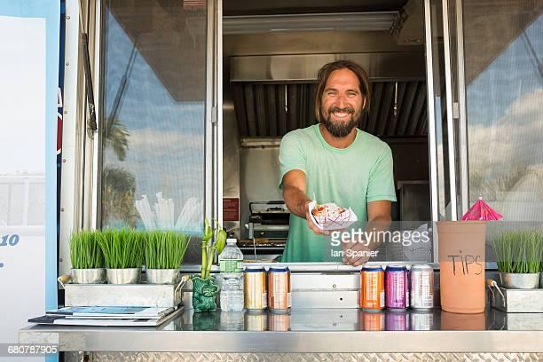 Portrait of man in fast food trailer