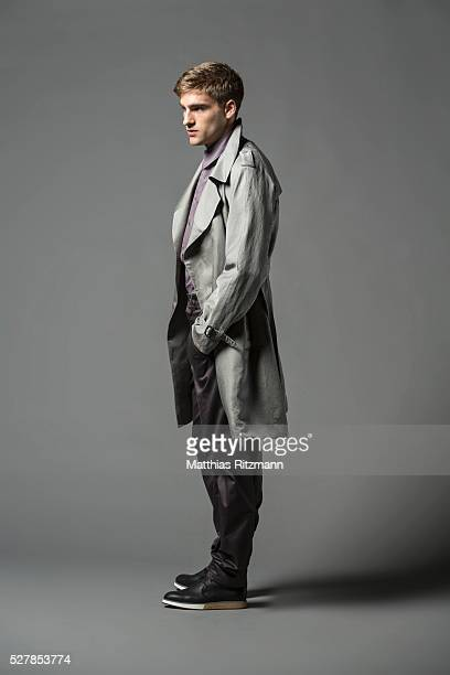 portrait of man in grey coat - overcoat stock pictures, royalty-free photos & images