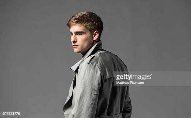 Portrait of man in grey coat