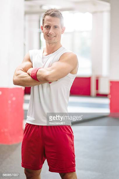 portrait of man in gym - three quarter length stock pictures, royalty-free photos & images
