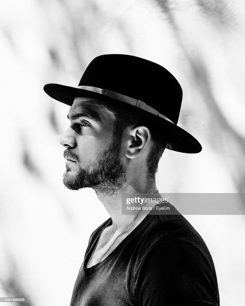Portrait Of Man In Hat Looking Away : Stock Photo