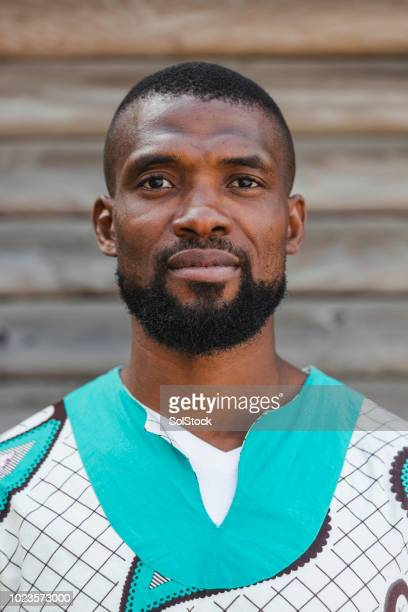 portrait of man in hipster african garment - dashiki stock photos and pictures