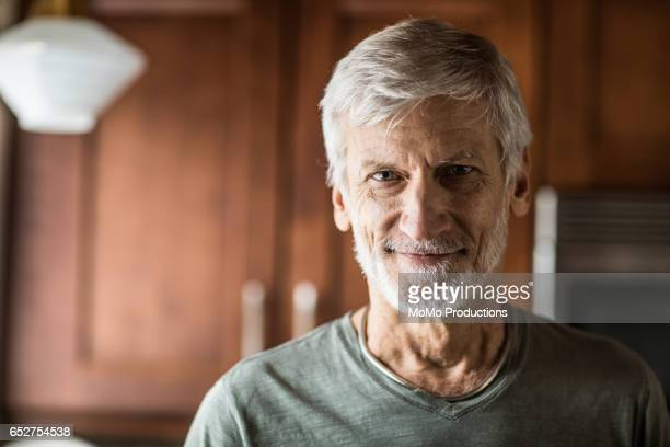 portrait of man (60yrs) in kitchen - part of a series stock pictures, royalty-free photos & images