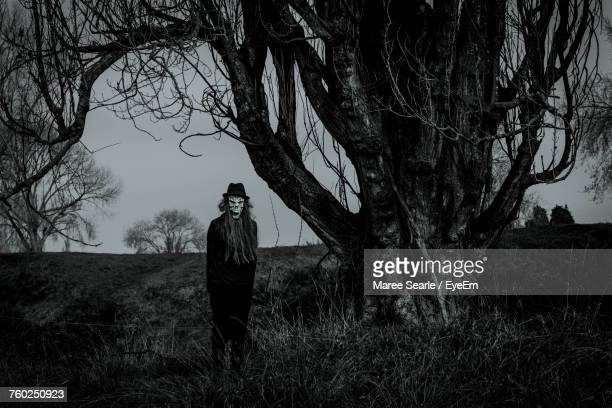 portrait of man in mask - scary setting stock photos and pictures