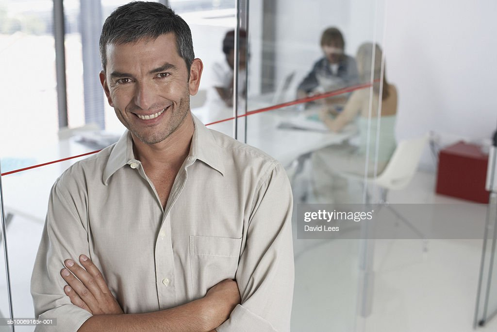 Portrait of man in office : Stockfoto