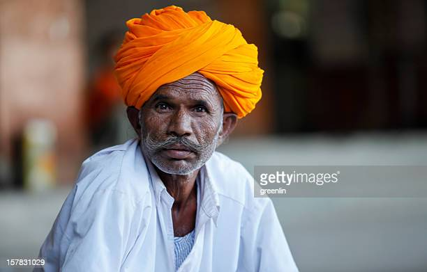 Portrait of man in orange turban