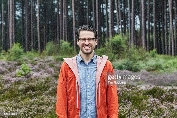 Portrait of man in outdoor clothes, bad weather.