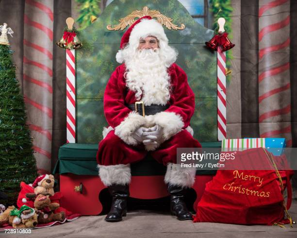 portrait of man in santa claus costume - santa stock photos and pictures