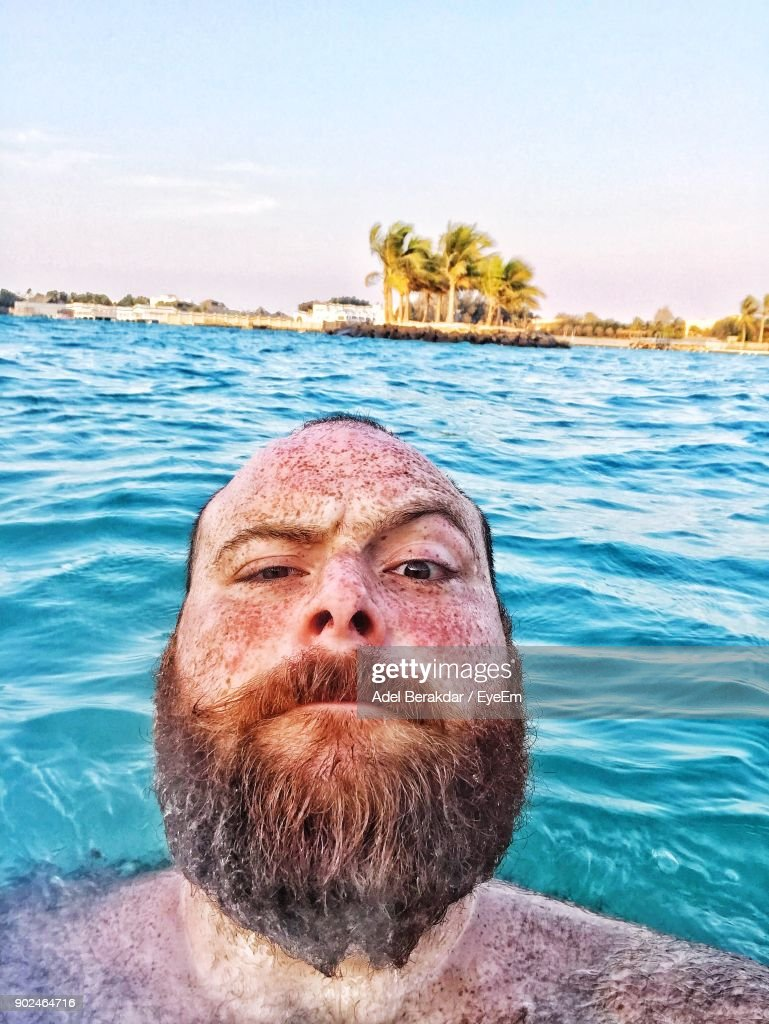Portrait Of Man In Sea Against Sky : Stock Photo