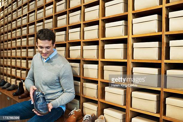 Portrait of man in shoe store browsing shoes