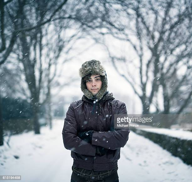 portrait of man in snowy landscape - fur hat stock photos and pictures