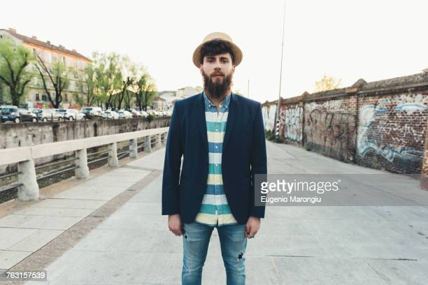 portrait of man in straw boater by canal - straw boater hat stock pictures, royalty-free photos & images