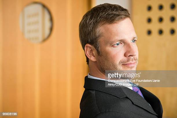 "portrait of man in suit - ""compassionate eye"" stock pictures, royalty-free photos & images"