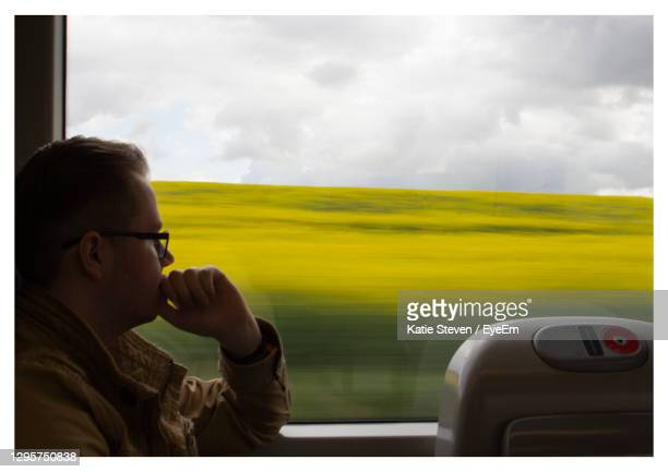 portrait of man in train against sky - dundee scotland stock pictures, royalty-free photos & images