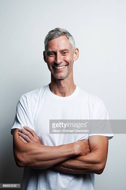 portrait of man in white t-shirt in his 50's - europäischer abstammung stock-fotos und bilder