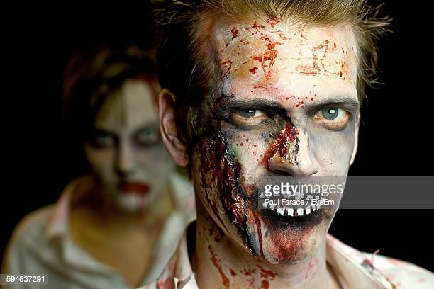 portrait of man in zombie make-up during halloween - zombie makeup stock photos and pictures