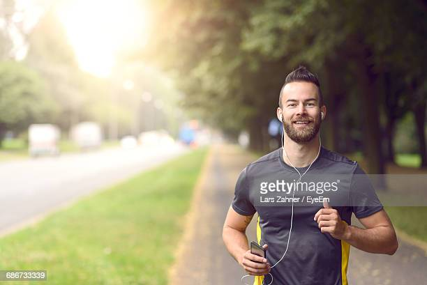 portrait of man jogging - jogging stock photos and pictures