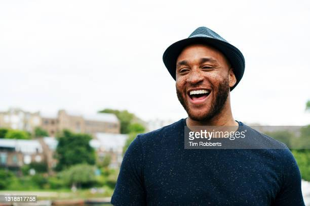 portrait of man laughing - mid adult men stock pictures, royalty-free photos & images