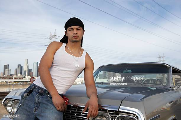 portrait of man leaning on car - gang stock pictures, royalty-free photos & images